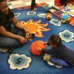 pawtucket.infant.playing.teacher
