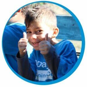 preschool thumbs up happy child