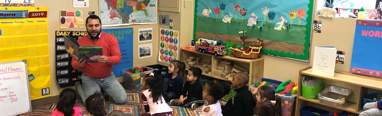 Representative Tobon reads to DDC Pawtucket Concord St. children